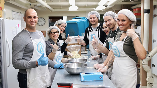 Group Volunteers giving thumbs up in Bissell's kitchen